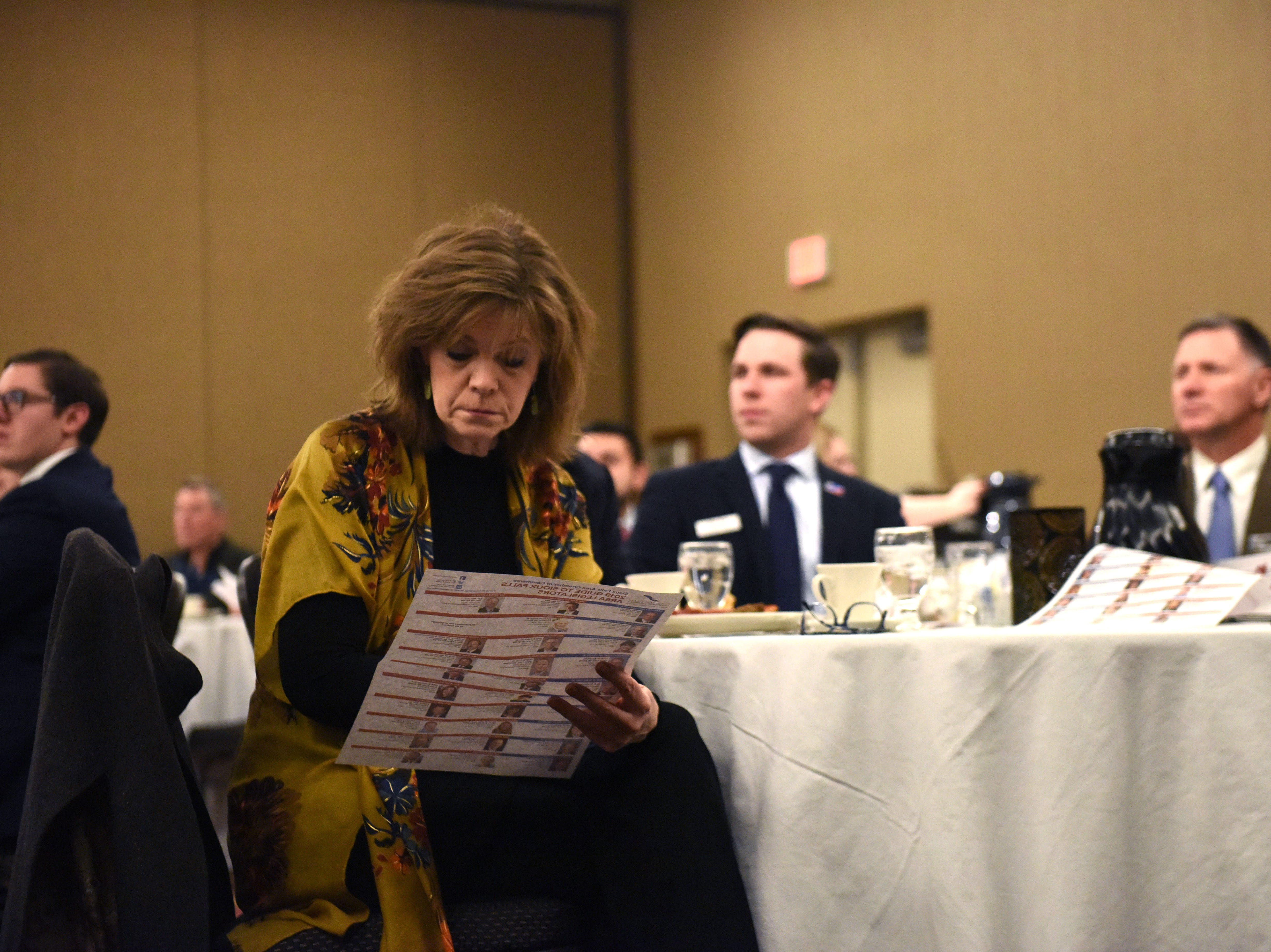 Attendee looks over the Sioux Falls legislators guide at the Chamber of Commerce legislative breakfast, Thursday, Jan. 3, 2019 at the Best Western Plus Ramkota Hotel in Sioux Falls, S.D.