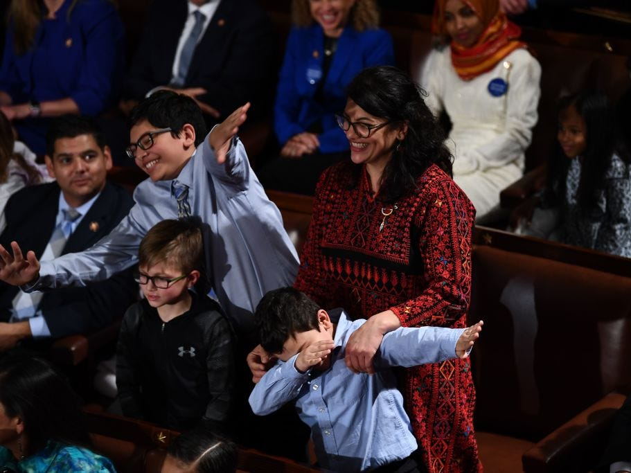 Member-elect Rashida Tlaib(D-MI) plays with her children during the 116th Congress and swearing-in ceremony on the floor of the US House of Representatives at the US Capitol on January 3, 2019 in Washington,DC.