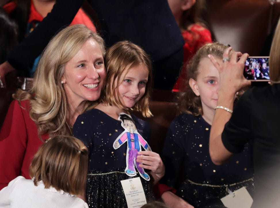 Member-elect Abigail Spanberger (D-VA) poses for a photo with her kids before the first session of the 116th Congress at the U.S. Capitol January 03, 2019 in Washington, DC. Under the cloud of a partial federal government shutdown, Speaker-designate Rep. Nancy Pelosi (D-CA) will reclaim her former title as speaker and her fellow Democrats will take control of the House of Representatives for the second time in eight years.
