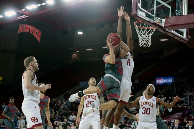 Cody Kelley drives for what become the winning shot against Denver on Wednesday night at Magness Arena .