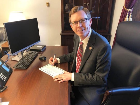 South Dakota Rep. Dusty Johnson signs his oath of office after being sworn in as a member of the 116th Congress on Thursday in Washington, D.C.