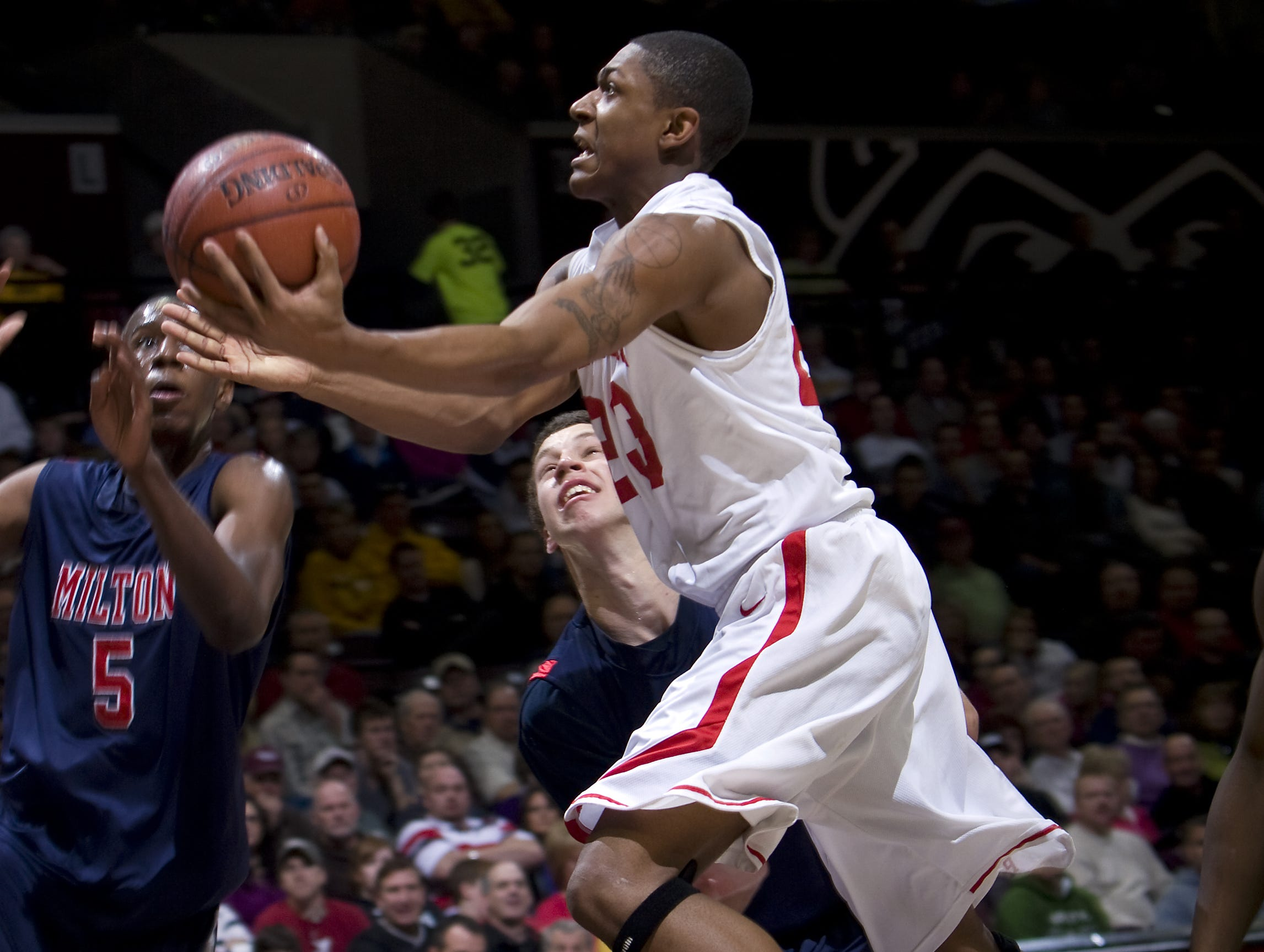 Chaminade College Prep guard Bradley Beal, top center, attempts a shot over the defense of Milton High School teammates Shannon Scott, left, and Evan Nolte, bottom center, in the opening round of the 2010 Bass Pro Tournament of Champions.