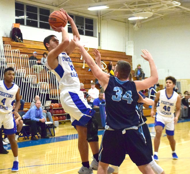 Robert E. Lee's Nicholas Jones gets off a fadeaway jumper during the first half of the Leemen's Shenandoah District boys basketball game against Page County on Wednesday, Jan. 2, 2019, at Paul Hatcher Gym in Staunton, Va.