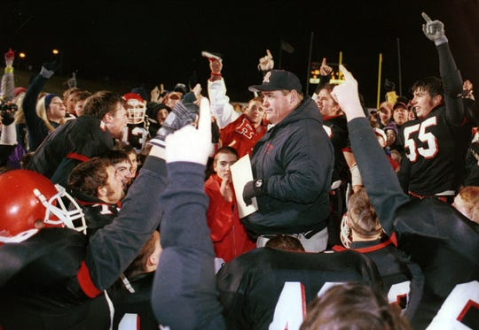 Robert Casto talks to his players after Riverheads defeated Bath County to win the 2000 Group A, Division 1 championship, the program's first title.