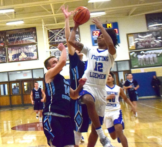 Robert E. Lee's Elijah Simms goes up for a shot during the first half of the Leemen's Shenandoah District boys basketball game against Page County on Wednesday, Jan. 2, 2019, at Paul Hatcher Gym in Staunton, Va.