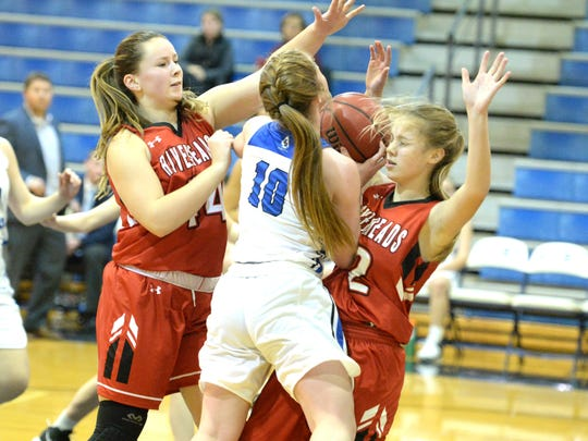 Fort Defiance's Bri Allen tries to get a shot up against a pair of Riverheads defenders, Berkeley Tyree (44) and Savanna Crawford (12).