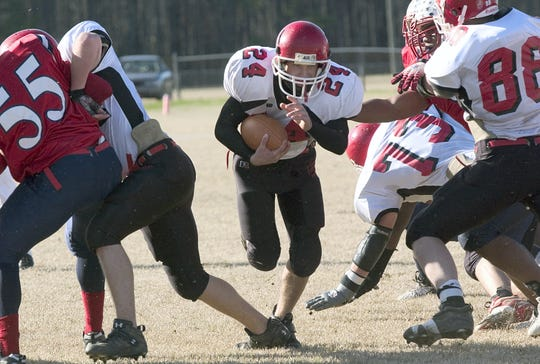 Josh Cash breaks through the line during Riverheads' victory over Sussex Central in the 2006 Group A, Division 1 semifinals.