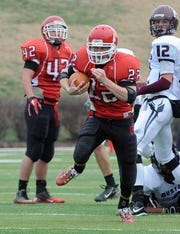 Riverheads' Logan Moore breaks away for a big gain during the 2010 VHSL Group A, Division 1 championship game.