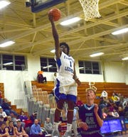 Robert E. Lee's Javon Battle drives in for a layup in the first half of the Leemen's Shenandoah District boys basketball game against Page County on Wednesday, Jan. 2, 2019, at Paul Hatcher Gym in Staunton, Va.