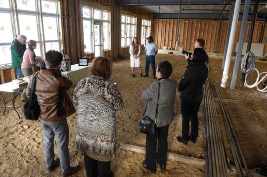 People listen as Erin Lucas and Mateo Mackbee talk about plans for their new restaurant Krewe during a press conference Thursday, Jan. 3, at the 24 North Lofts development in St. Joseph.