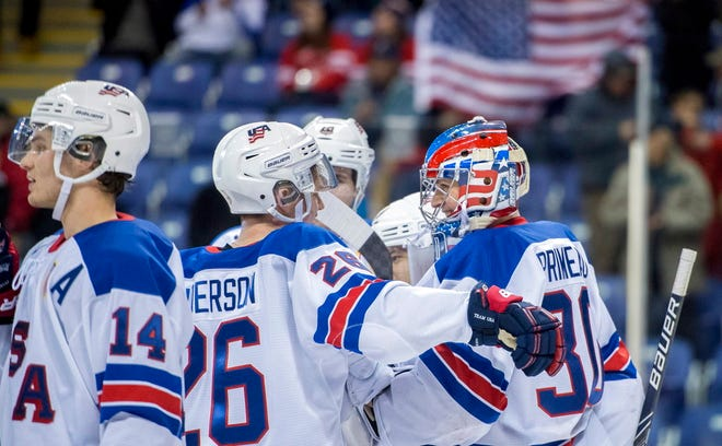 U.S. players celebrate a win over the Czech Republic during the quarterfinals of the world junior hockey championships, Wednesday, Jan. 2,  in Victoria, British Columbia.