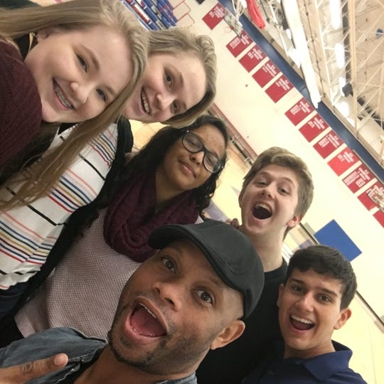 St. Cloud high schoolers post with motivational speaker A'ric Jackson, center, on Dec. 7 at Apollo High School. Also pictured are, from left, Chelsea Cremers, Emily Roiland, Jamila Omar, Sam Breuer and Will Galler.