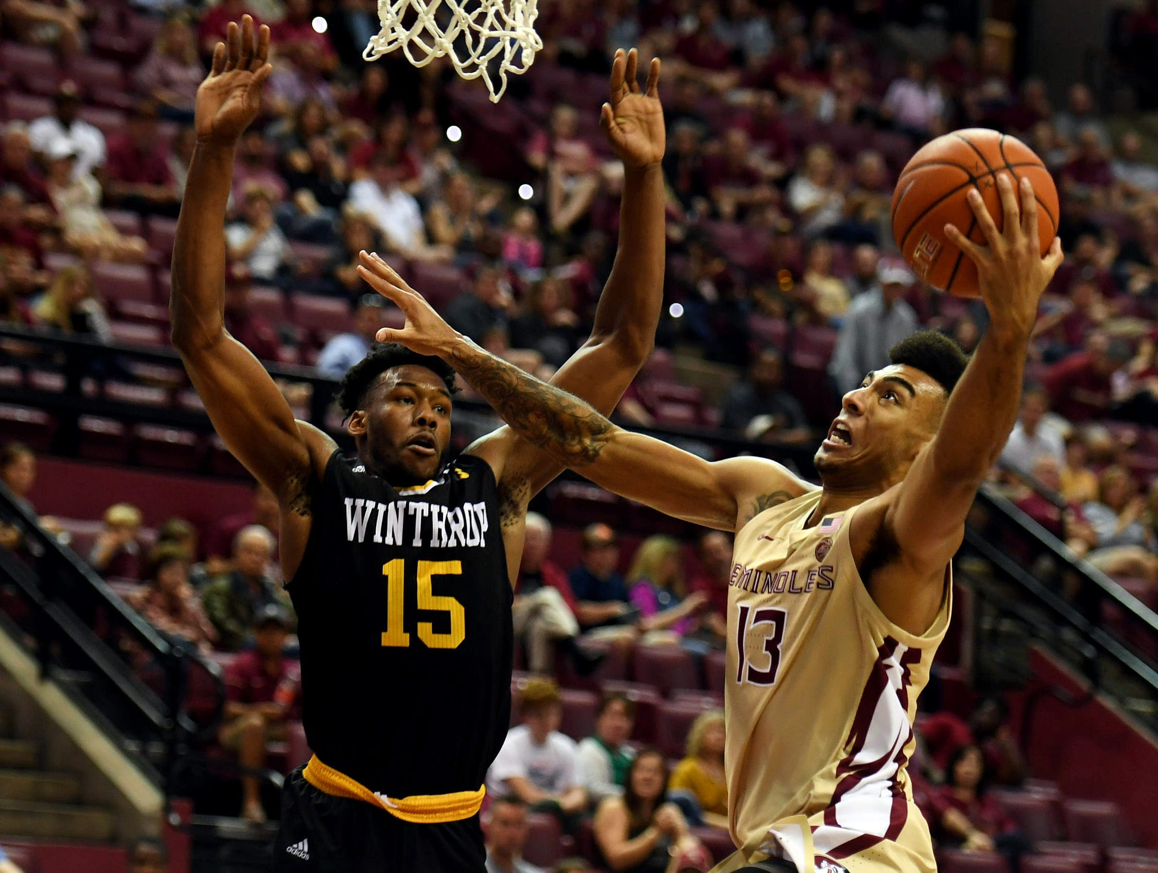 Jan 1, 2019; Tallahassee, FL, USA; Florida State Seminoles guard Anthony Polite (13) shoots the ball against Winthrop Eagles forward Jermaine Ukaegbu (15) during the game at Donald L. Tucker Center. Mandatory Credit: Melina Myers-USA TODAY Sports
