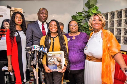 Kamilah Campbell (center) is joined at a press conference with civil rights attorney Ben Crump (second from left) and her family members. Campbell said her SAT scores were wrongfully being withheld.