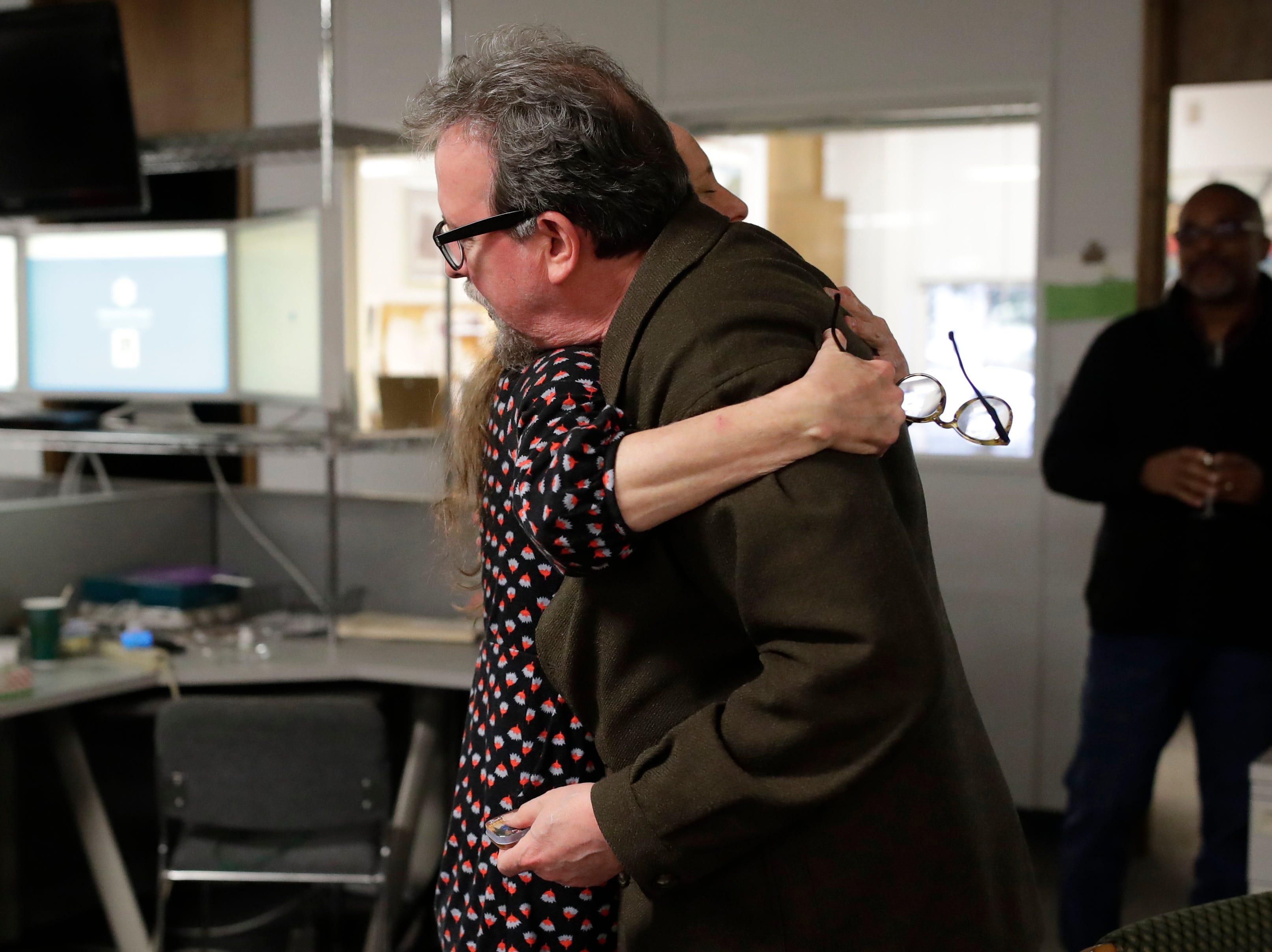 News Director Jennifer Portman hugs Former Arts and Entertainment Editor Mark Hinson on his last day of work at the Tallahassee Democrat Wednesday, Jan. 2, 2019.