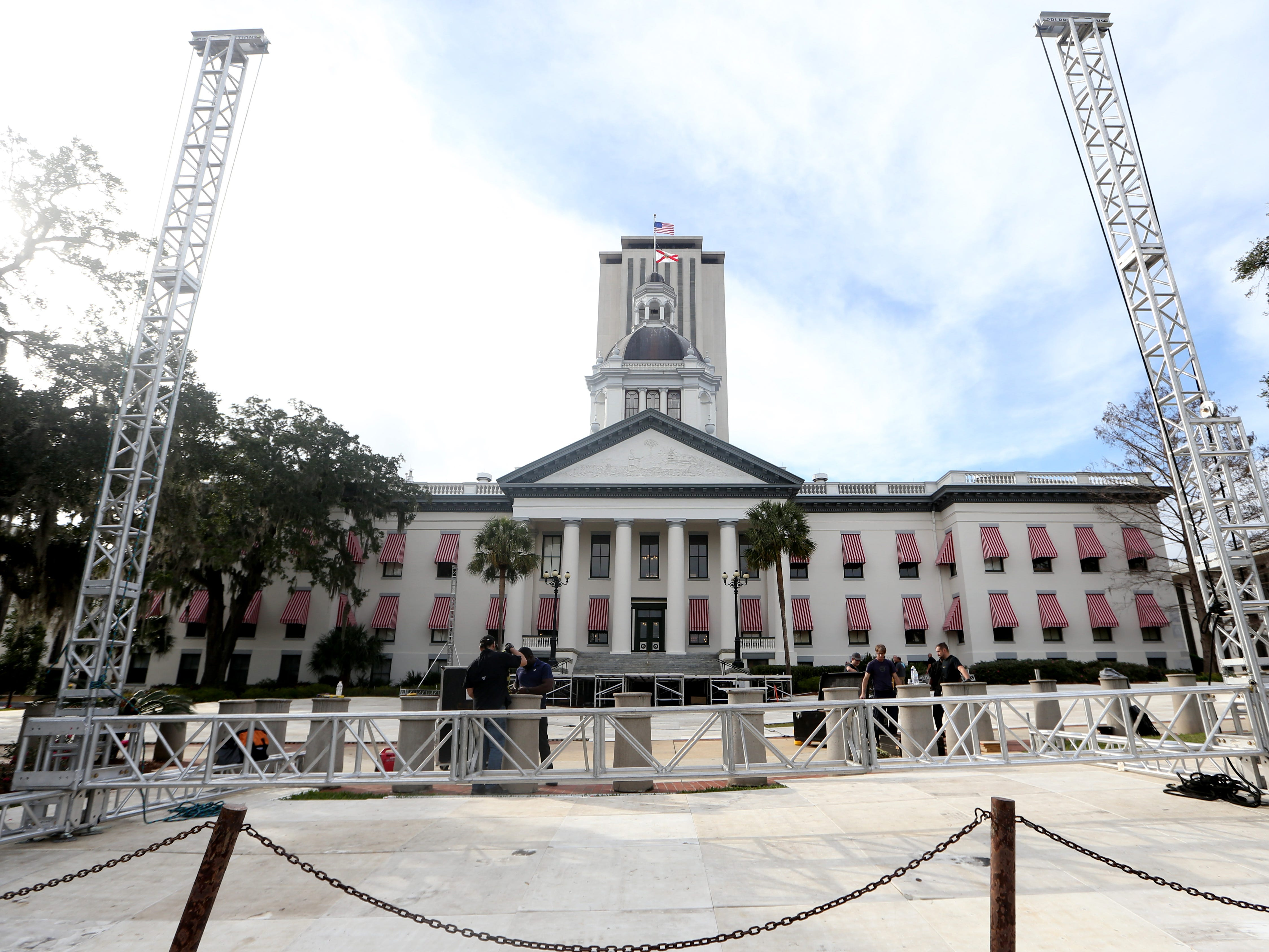 A crew of men setup a stage and video screen area outside the Florida's Historic Capitol, Thursday, Jan. 3, 2019. The setup is in preparation for the Swearing-In Ceremony which will take place on the morning of Tuesday, Jan 8, 2019.