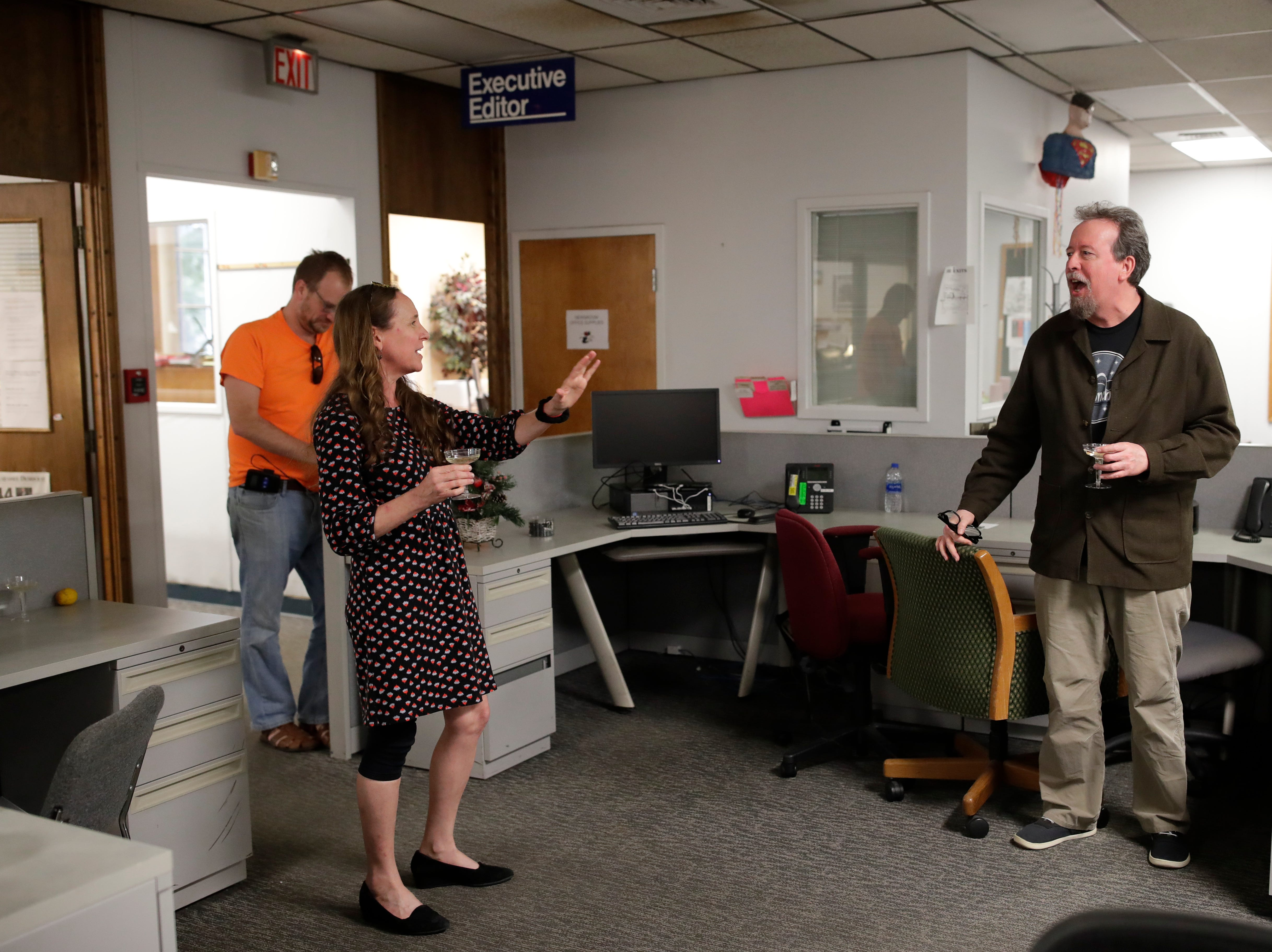 News Director Jennifer Portman gives a toast to Former Arts and Entertainment Editor Mark Hinson on his last day of work at the Tallahassee Democrat Wednesday, Jan. 2, 2019.