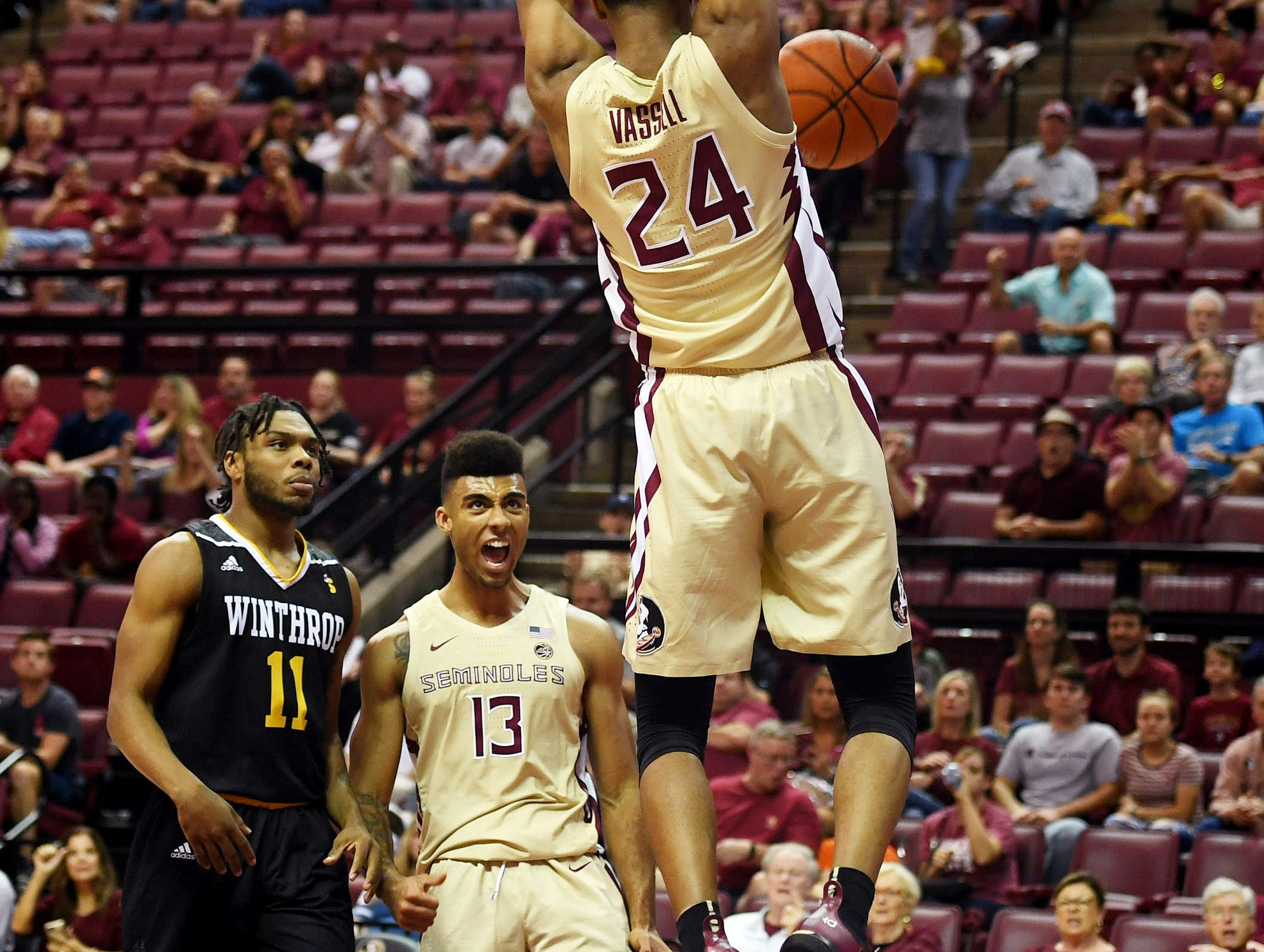Jan 1, 2019; Tallahassee, FL, USA; Florida State Seminoles guard Devin Vassell (24) dunks the ball during the first half against the Winthrop Eagles at Donald L. Tucker Center. Mandatory Credit: Melina Myers-USA TODAY Sports