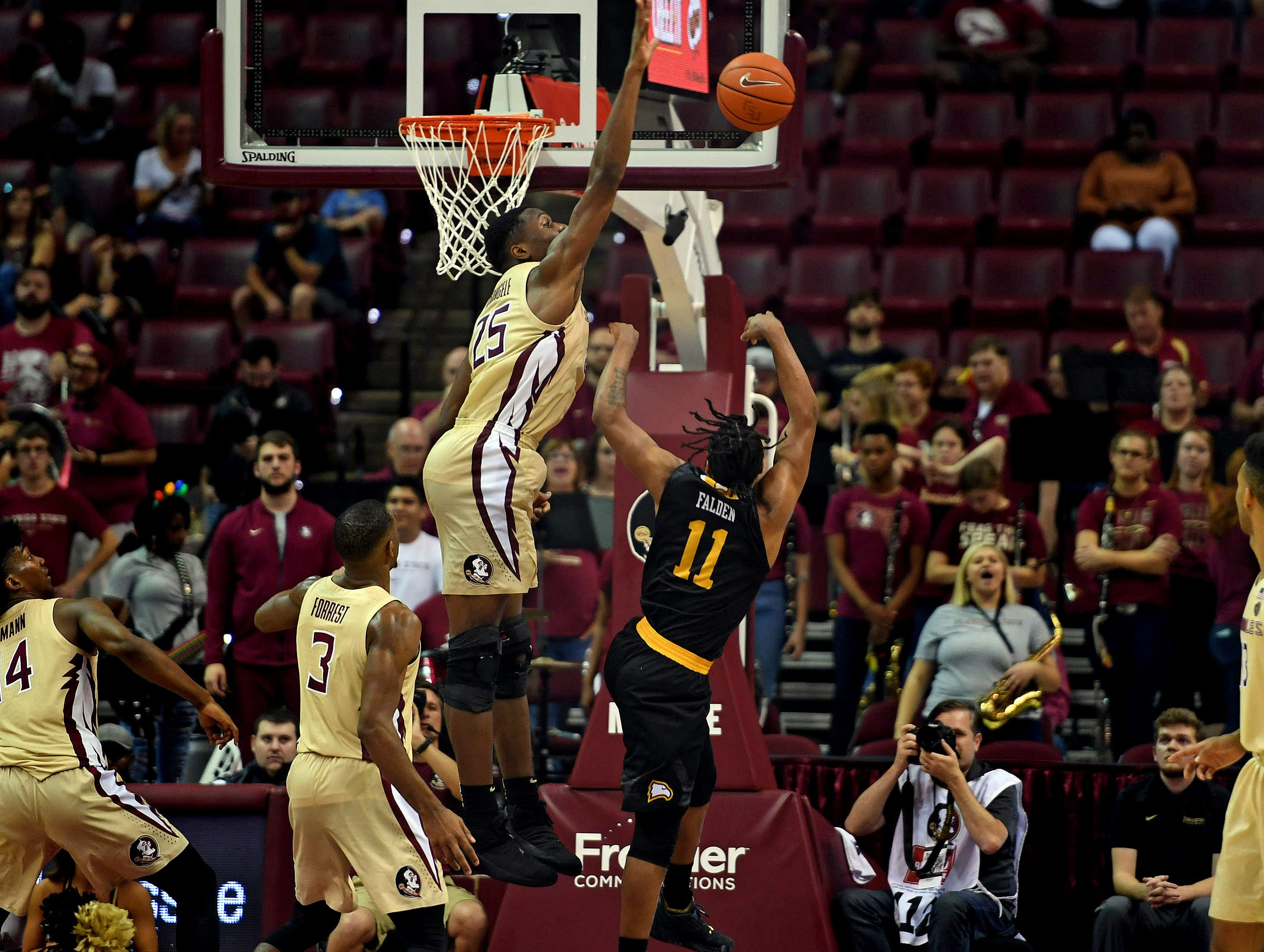 Jan 1, 2019; Tallahassee, FL, USA; Florida State Seminoles forward Mfiondu Kabengele (25) blocks a shot by Winthrop Eagles guard Charles Falden (11) during the game at Donald L. Tucker Center. Mandatory Credit: Melina Myers-USA TODAY Sports
