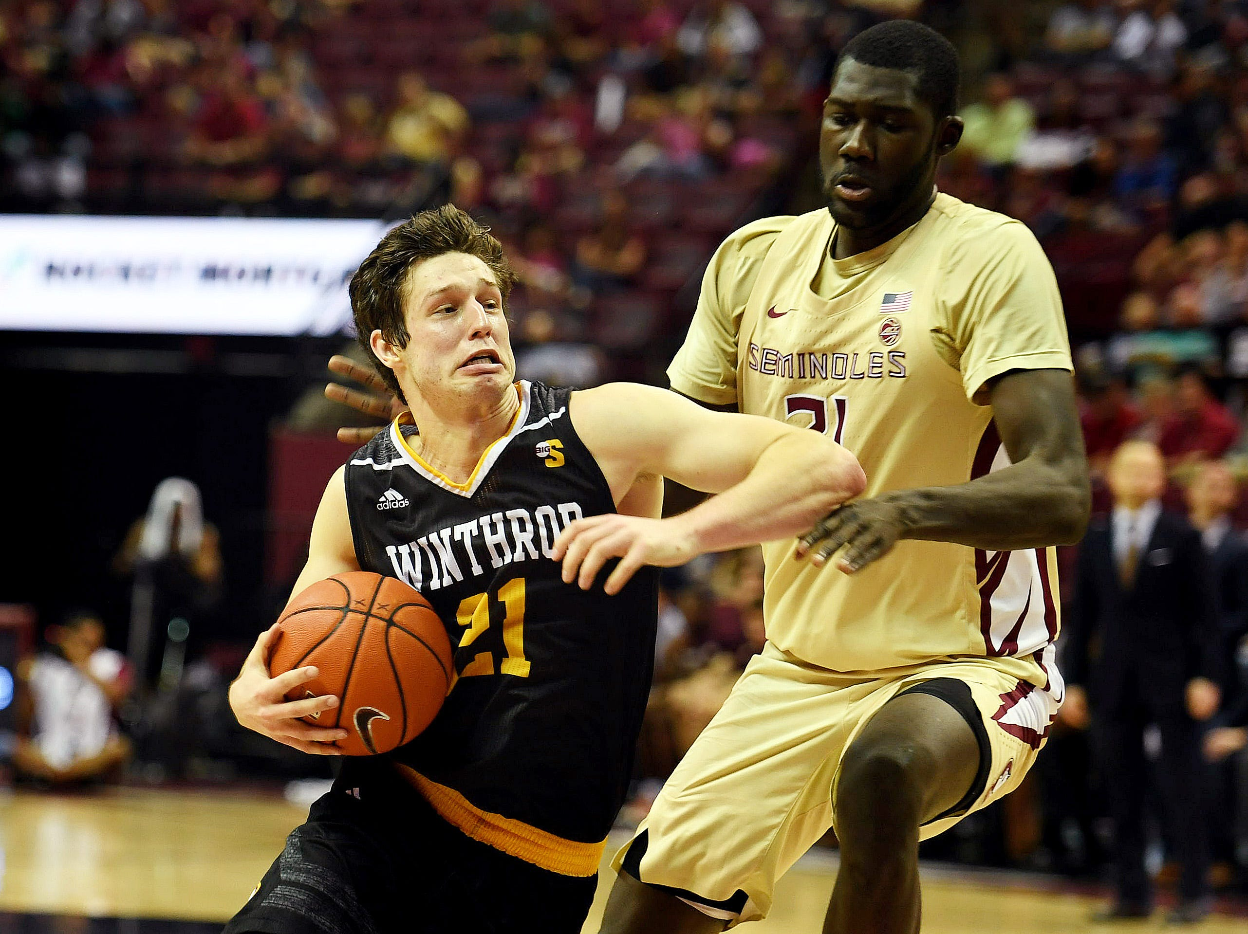 Jan 1, 2019; Tallahassee, FL, USA; Winthrop Eagles guard Kyle Zunic (21) dribbles the ball around Florida State Seminoles center Christ Koumadje (21) during the first half at Donald L. Tucker Center. Mandatory Credit: Melina Myers-USA TODAY Sports