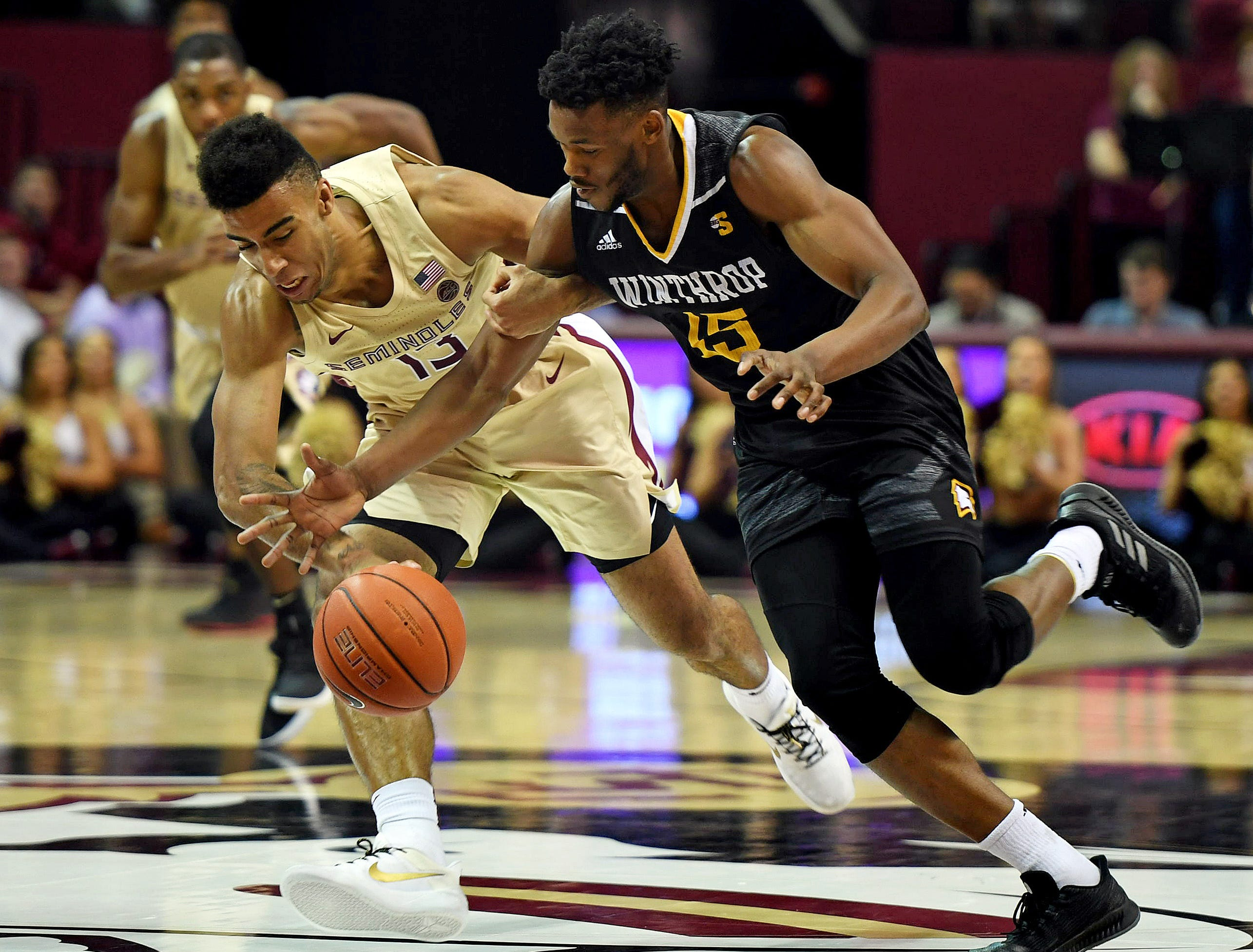 Jan 1, 2019; Tallahassee, FL, USA; Florida State Seminoles guard Anthony Polite (13) battles for a loose ball with Winthrop Eagles forward Jermaine Ukaegbu (15) during the game at Donald L. Tucker Center. Mandatory Credit: Melina Myers-USA TODAY Sports