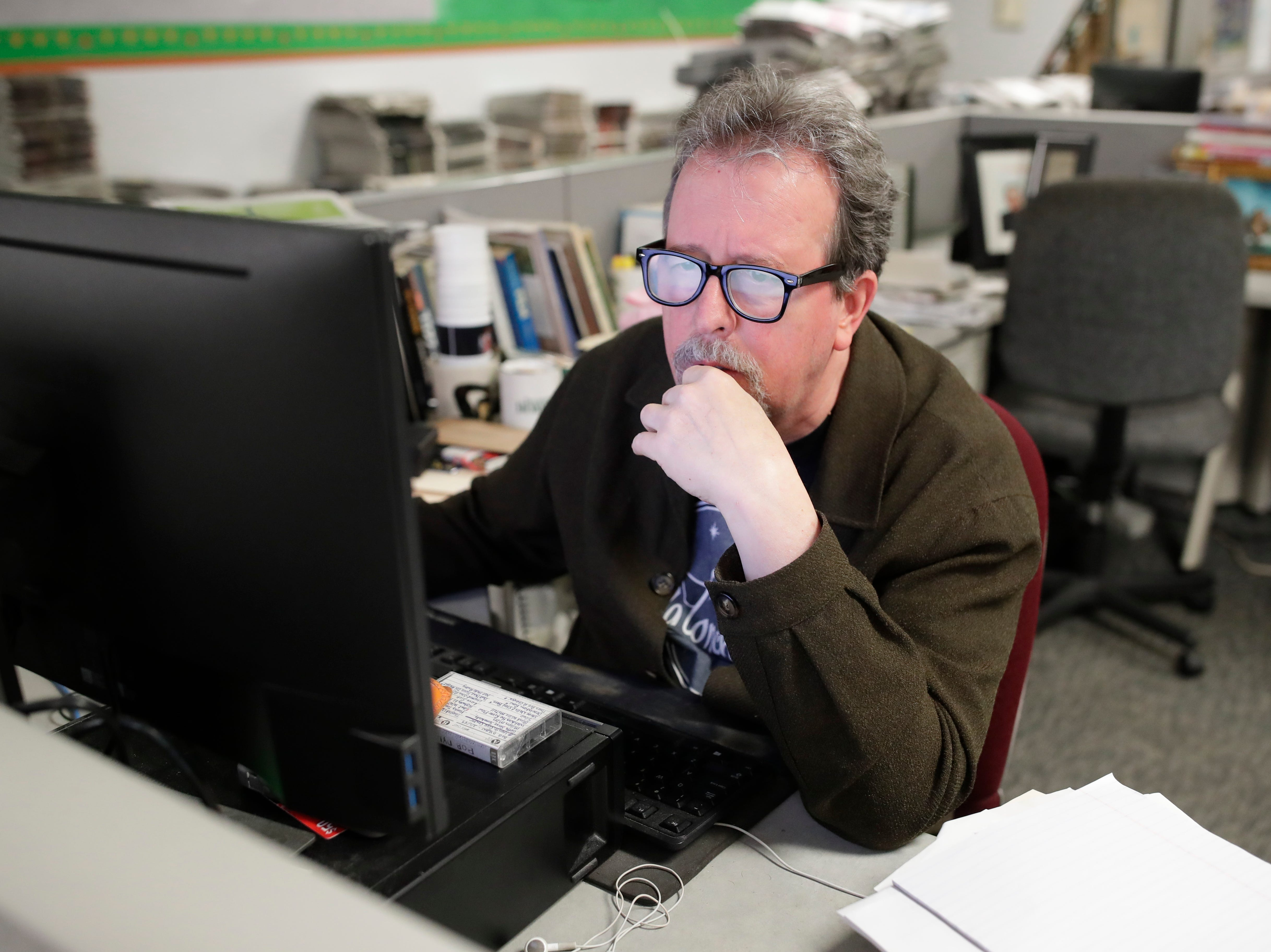 Former Arts and Entertainment Editor Mark Hinson works at this desk on his last day at the Tallahassee Democrat Wednesday, Jan. 2, 2019.