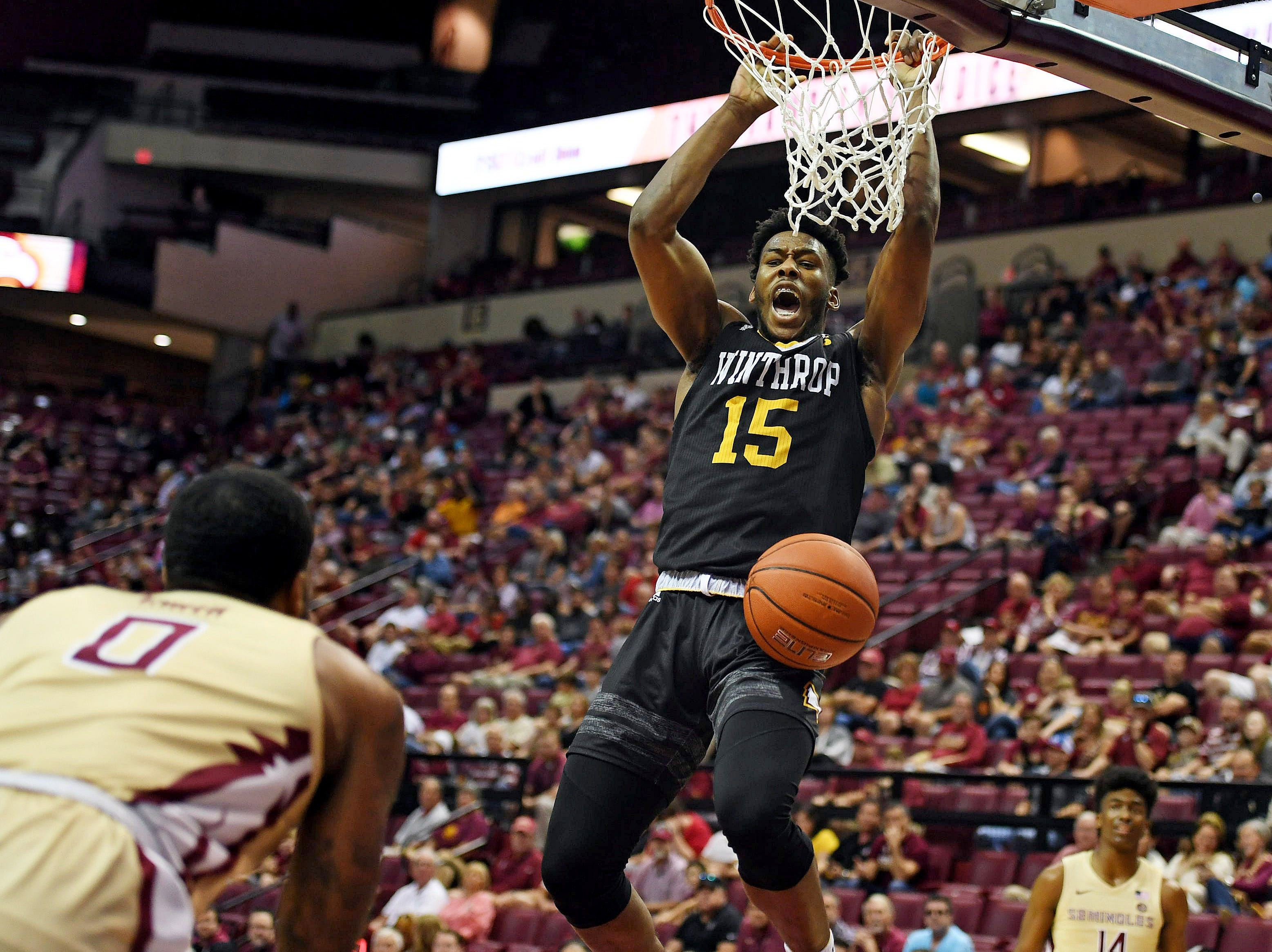 Jan 1, 2019; Tallahassee, FL, USA; Winthrop Eagles forward Jermaine Ukaegbu (15) dunks the ball during the first half of the game against the Florida State Seminoles at Donald L. Tucker Center. Mandatory Credit: Melina Myers-USA TODAY Sports