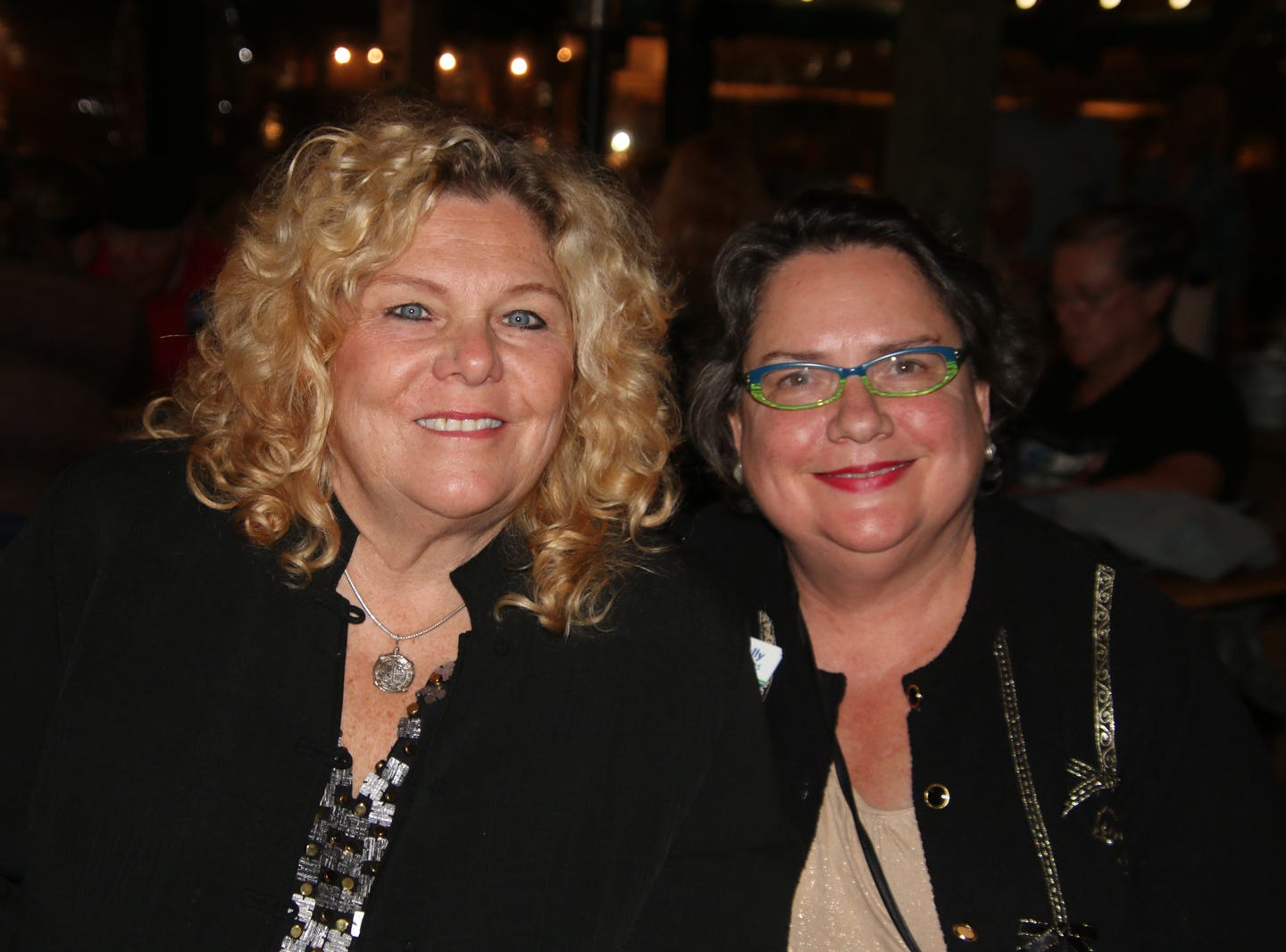 Anita Prentice, left, and Holly Theuns enjoy the music at the Fort Pierce Jazz & Blues Society's  Ring-a-Ding-Ding Holiday Fling at Summer Crush Vineyard & Winery.