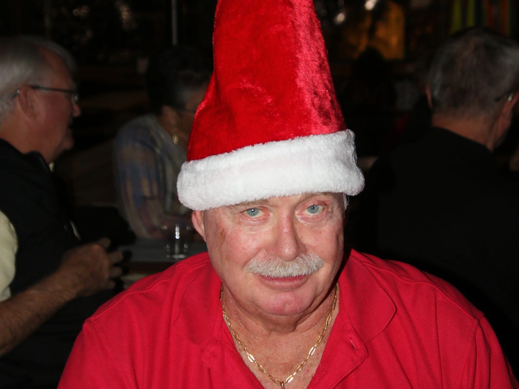 """George McDaniel with his Santa """"dunce"""" cap at the Fort Pierce Jazz &Blues Society's Ring-a-Ding-Ding Holiday Fling at Summer Crush Vineyard & Winery."""