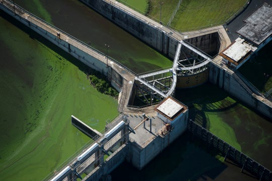 Algae builds up at the gates of Port Mayaca, where Lake Okeechobee water is transferred to the C-44 Canal before it reaches the St. Lucie River, on Thursday, July 5, 2018, in Martin County.