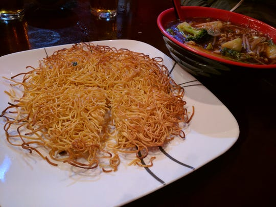 Pan-fried noodles with vegetables at Shandong Noodle House in Vero Beach.