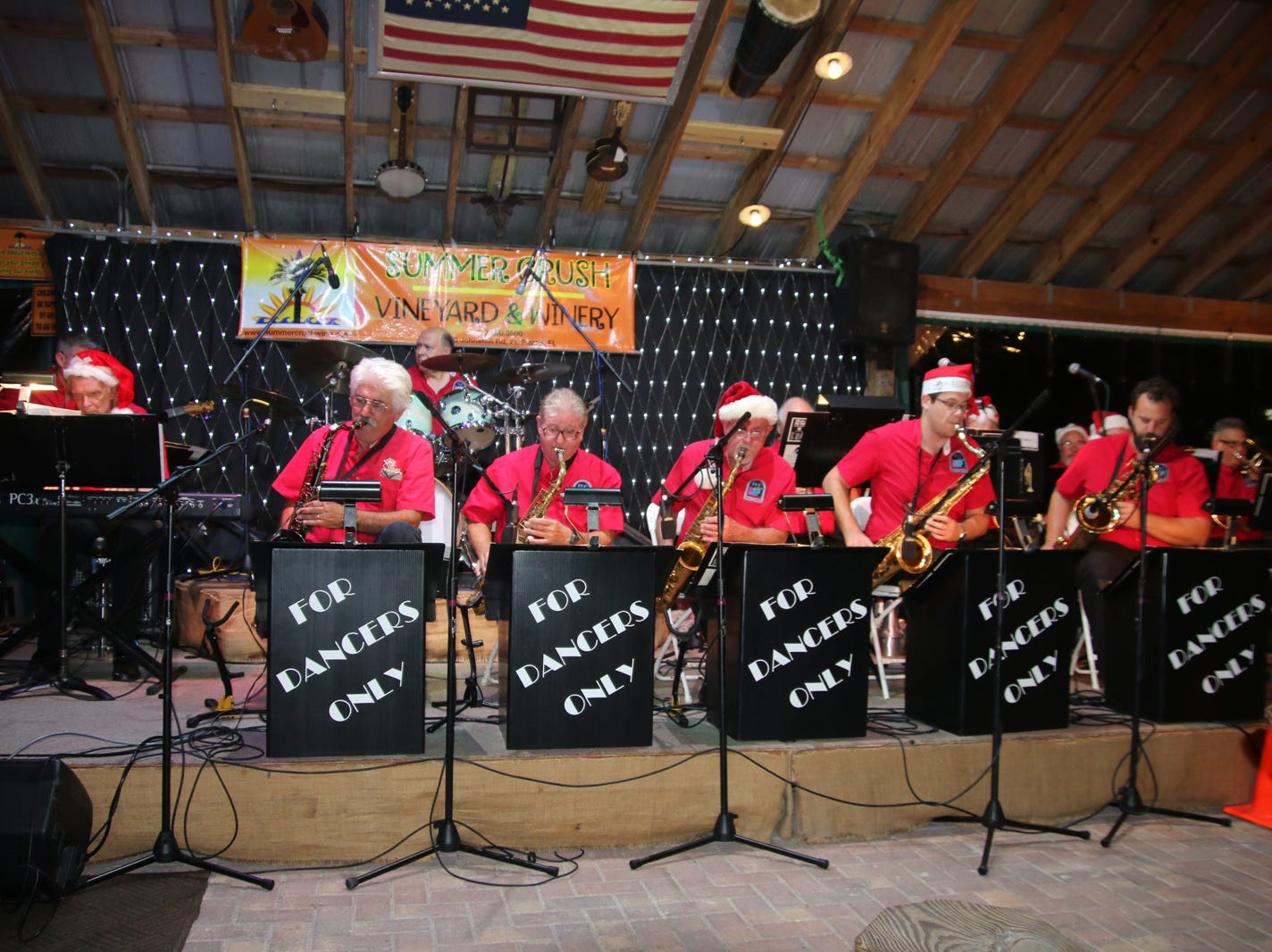 Members of FDO --the big swinging band For Dancers Only -- perform at the Fort Pierce Jazz &Blues Society's Ring-a-Ding-Ding Holiday Fling at Summer Crush Vineyard & Winery.