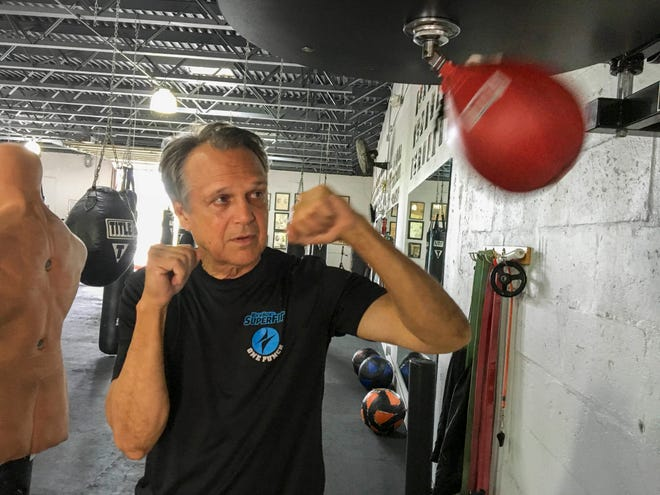 Steve Shepherd, a world champion kickboxer, works out Thursday, Jan. 3, 2019, in West Palm Beach. Shepherd was limping to his car last week, a pulled muscle impairing his stride, when a mugger hit him in the head with a bottle and demanded his cellphone. Shepherd threw a right cross to the attacker's head, and then smashed a hook to his ribs, crumpling him. Bystanders interceded and the man escaped. Shepherd suffered a ruptured eardrum, a cut and bruise.