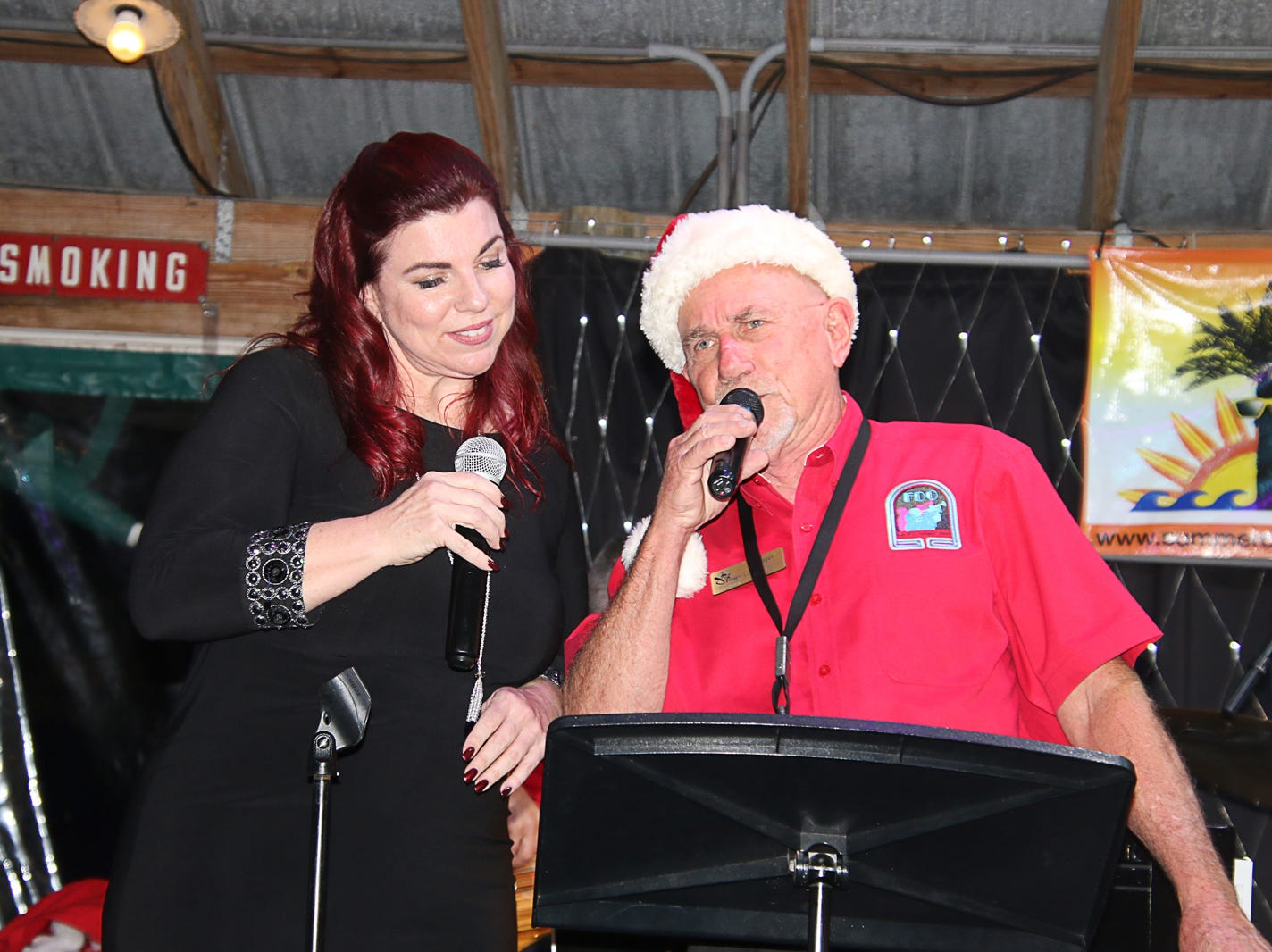 "Karin Leone and Al Hager singing ""Baby, It's Cold Outside"" at the Fort Pierce Jazz & Blues Society's Ring-a-Ding-Ding Holiday Fling at Summer Crush Vineyard & Winery."