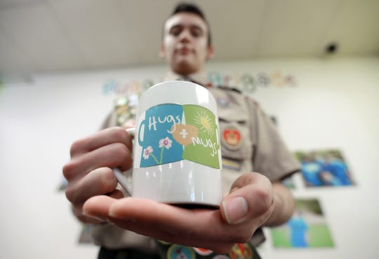 Boy Scout Marc Pacheco, a senior at Clint High School, just completed his Eagle Scout project, a Hugs and Mugs coffee kiosk which will be run by those with Down Syndrome at Gigi's Playhouse.