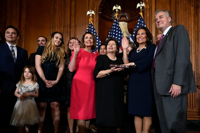 House Speaker Nancy Pelosi of California, left, poses during a ceremonial swearing-in with Rep. Veronica Escobar, D-Texas, on Capitol Hill in Washington, Thursday, Jan. 3, 2019, during the opening session of the 116th Congress.