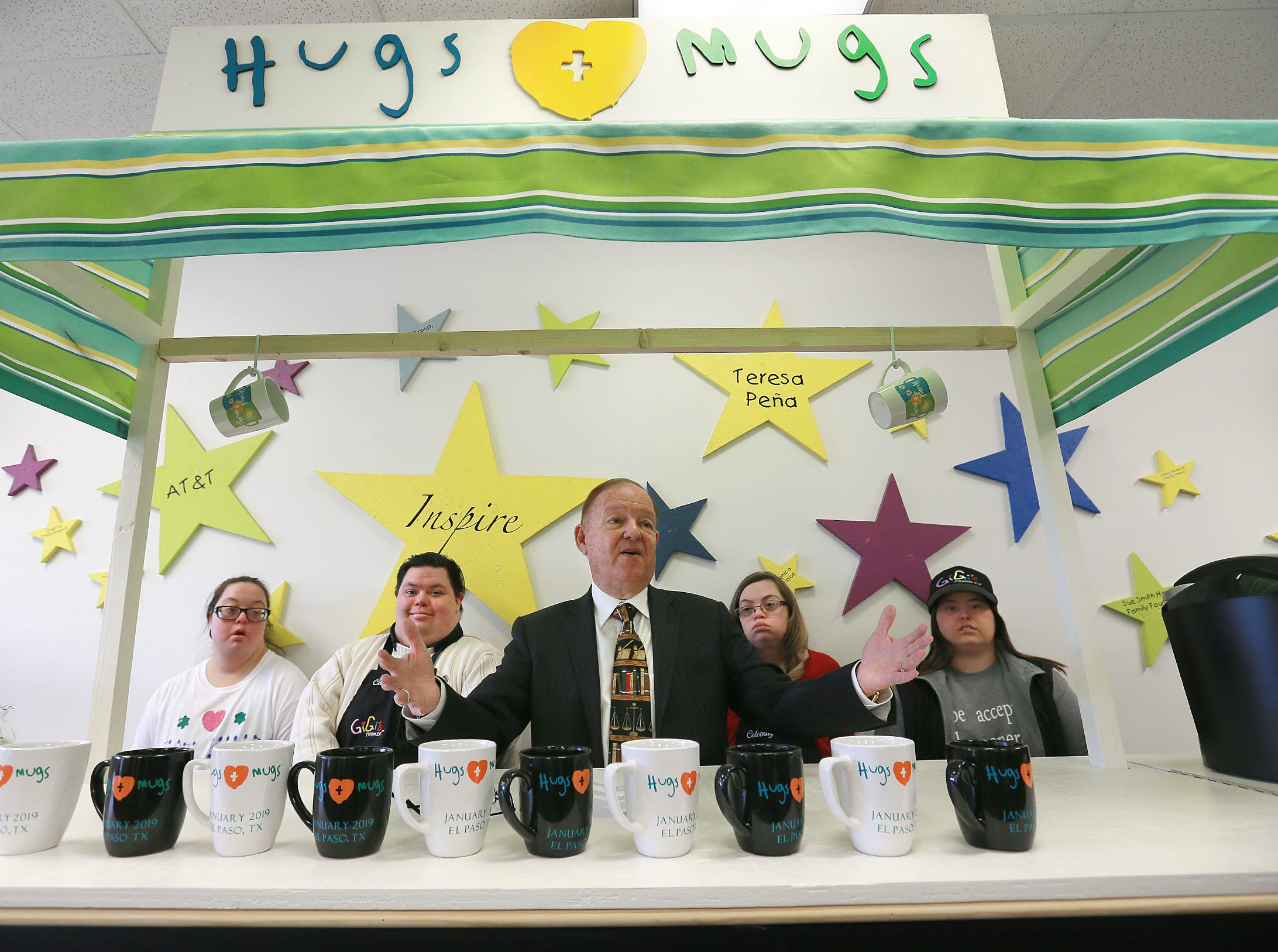 William E. Moody unveils the Hugs N Mugs kiosk at Gigi's Playhouse Thursday. The coffee shop was an Eagle Scout project by Clint High School senior Marc Pacheco.