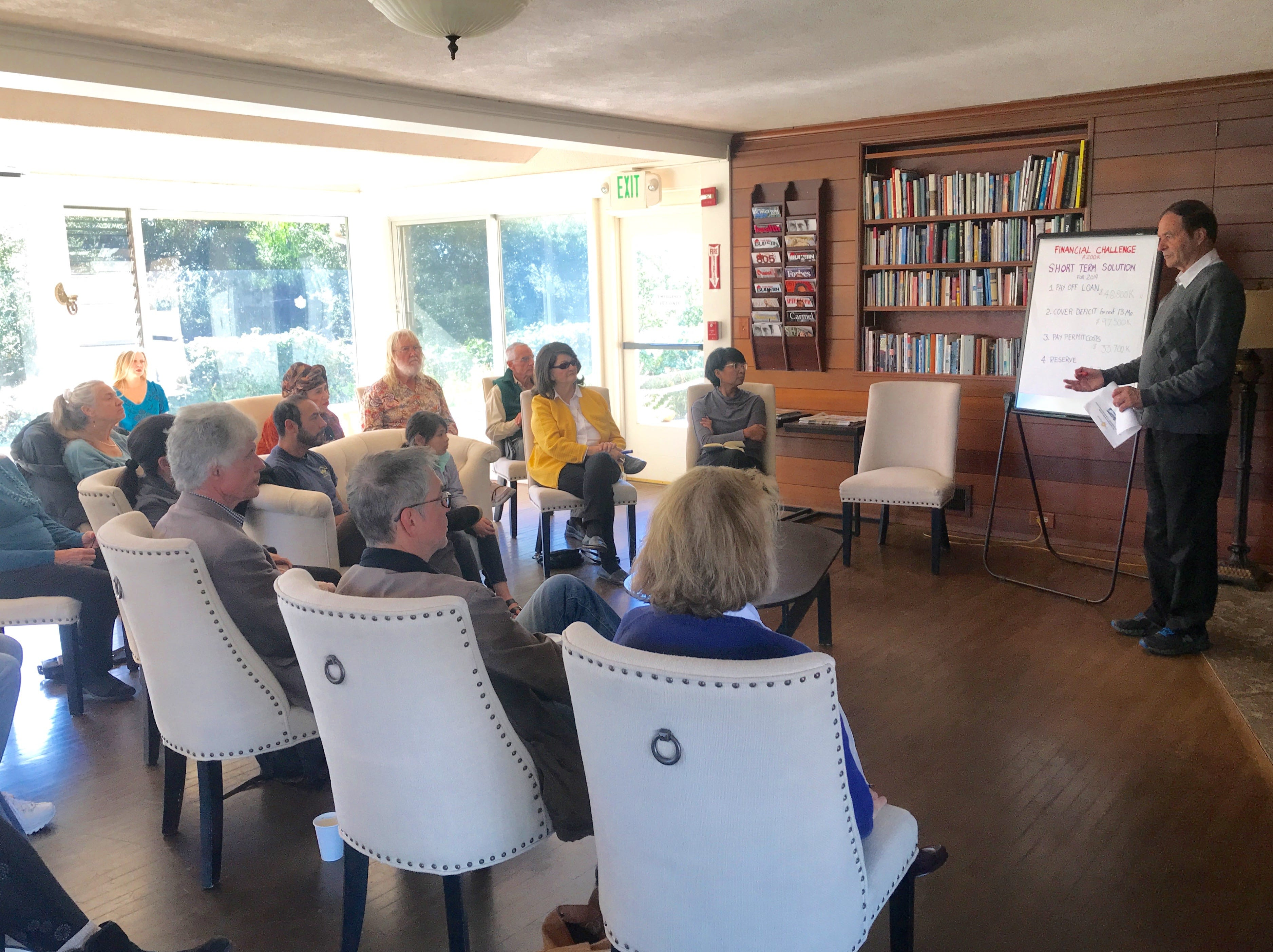 Ojai Retreat Executive Director Ulrich Brugger speaks to community members about the organization's financial situation during a meeting last month.
