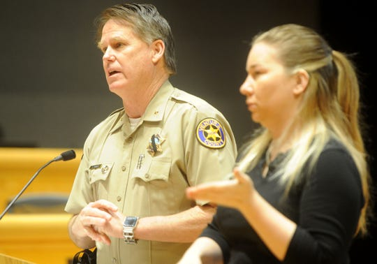 Thousand Oaks Chief Tim Hagel, left, with sign language interpreter Nadia Talley, spoke in 2018 during a Conejo Valley Victims Fund public forum at the Thousand Oaks Civic Arts Plaza.