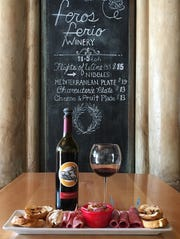 Craigleith, a 2013 sangiovese from Feros Ferio Winery, is shown with a charcuterie plate at The Vine in Ojai.'