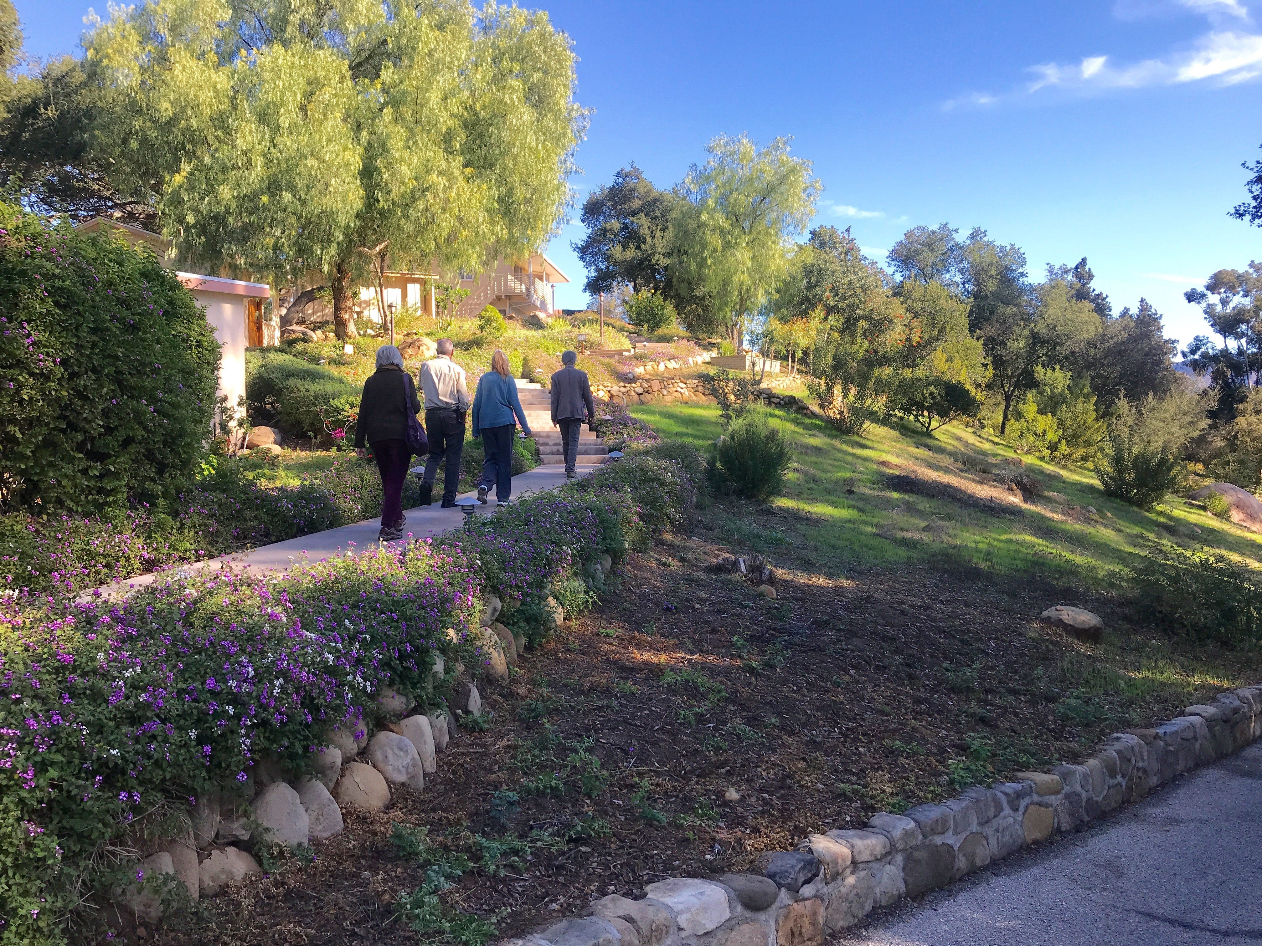 Visitors walk through the scenic grounds of the Ojai Retreat.