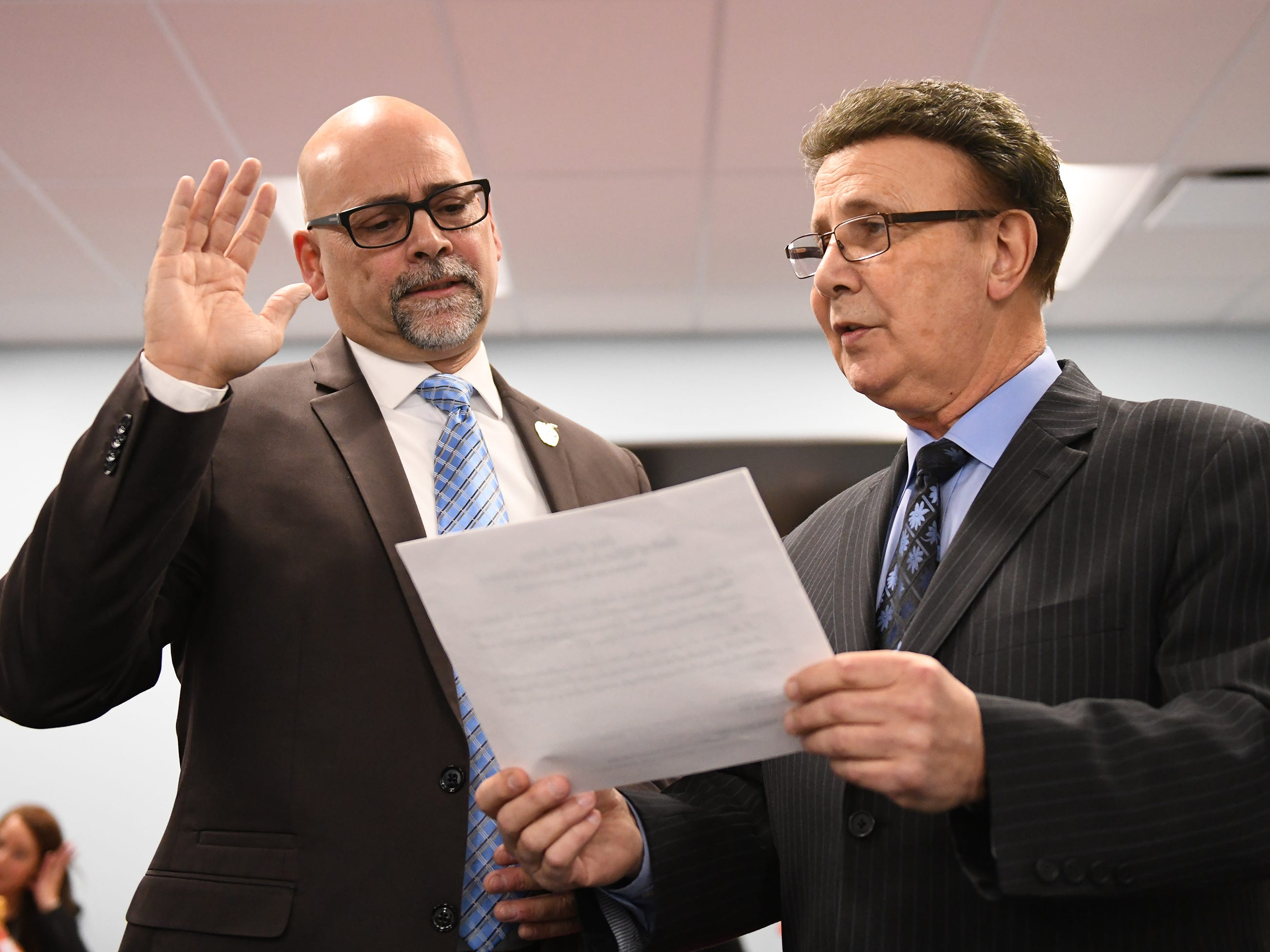 Scott E. English (left) takes the oath of office during a Vineland Board of Education reorganization meeting. Robert DeSanto takes part in the ceremony on Wednesday, January 2, 2019.