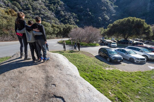 Sequoia National Park visitors make the best of features surrounding Hospital Rock during the partial shutdown on Wednesday, January 2, 2019. The road was closed to visitors at this point. Officials announced that the entire park would be closed this evening.