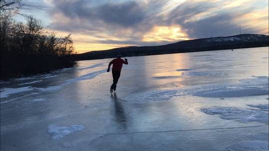 Mark Nicklawske of Duluth, Minnesota, skates on the Lake Wausau near Memorial Park as the sun sets behind Rib Mountain.