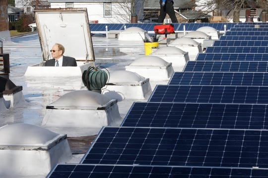 Bob Bergman, treasurer of the Good Shepherd Church in Pearl River peers at the work being done on the newly installed solar panels at the church on Jan. 3, 2019.