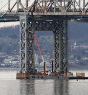 Workers are preparing the eastern section of the main span of the Tappan Zee Bridge for the use of explosives to bring it down Jan. 2, 2019. The demolition is scheduled to happen sometime this month.