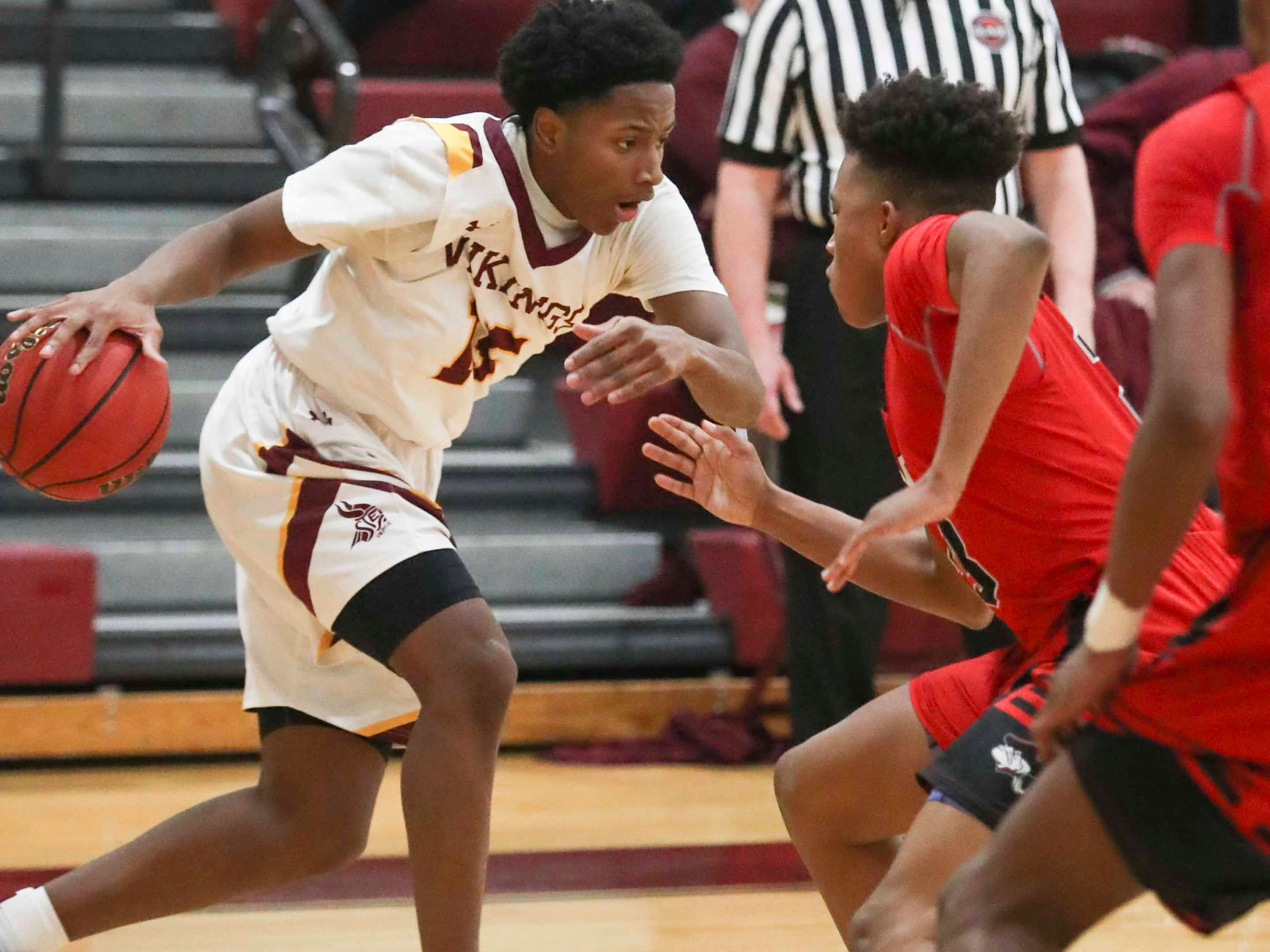 St. Elizabeth's Justin Money (left) drives as William Penn's Jaden Reed defends as the Colonials pull away in the second half to win 56-44 at the St. E Center Wednesday.