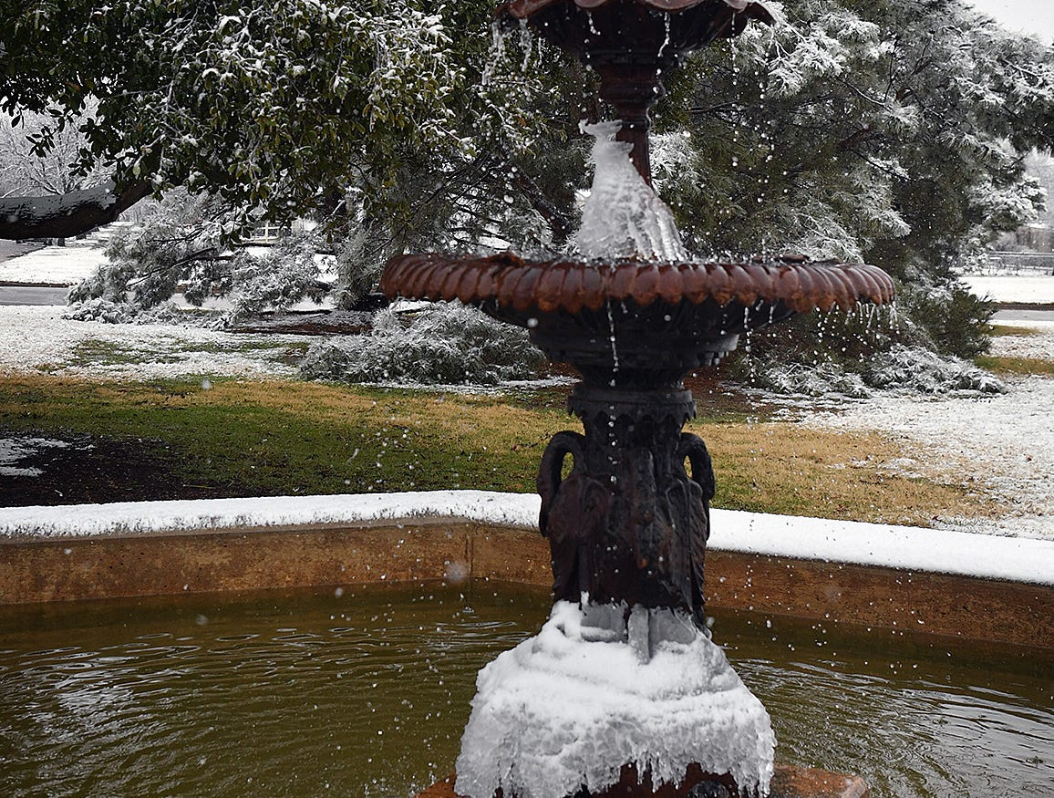 A fountain in Bridwell Park continued to flow as temperatures hovered around freezing Thursday afternoon.