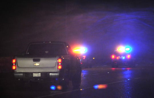 Wichita Falls police work the scene of a vehicle accident on the southbound side of I-44 Wednesday night after winter weather entered the area.