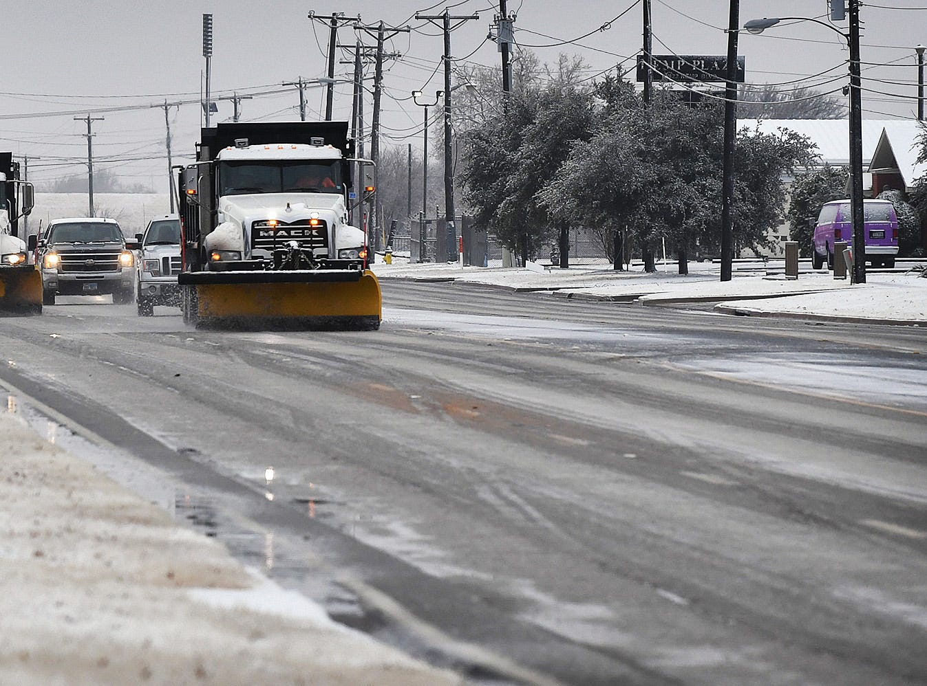 Snow plow trucks keep lanes of Kemp Boulevard clear Thursday morning. TXDoT workers have kept busy treating overpasses and spreading chat material for drivers dealing with slick roadways.